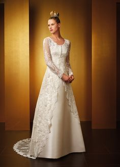 I love the over Lace on this gown - It's simply Elegant - Classic Class - from www.cheap-wedding-gowns.com - Wow!