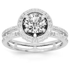 This exquisite diamond engagement ring is handcrafted in lustrous 18K white gold. The center is prong set with one round cut GIA certified 0.75 carat diamond which is G in color and VS2 in clarity. The small round cut side stones total to additional 0.50 carats. The center measures to 10 mm in diameter and the band weighs 4.6 grams. $6,673.00