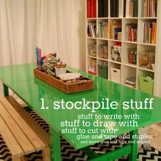 """TABLE FROM IKEA.  The owner took the table to an autobody shop to have them paint the table.  IKEA also has awesome black and white rugs.  Toying around with our """"eat in kitchen space"""" for the art room."""
