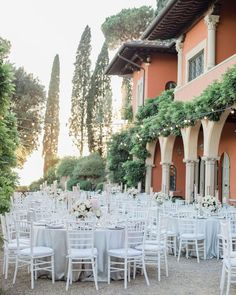 An al fresco wedding reception at Villa Le Fontanelle in Italy Planning & Design: The Tuscan Wedding Photography: Pure White Florals: Giardino Delle Fate Flower Design