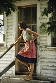 old farm house, adorable apron and bare feet = i can totally see myself standing on that porch barefoot in the summer. I love old farm houses/barns!
