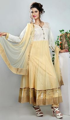 Make a grandstand appearance dressed in this cream and off white shade net Anarkali suit. The lace, resham and sequins work seems to be chic and great for any function. #CreamShimmerBorderChuridarAnarkali