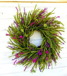 A Full Purple Wildflower Twig Wreath!! Great for Spring or Summer.... I started with a sunburst wreath and added artificial greenery, flowers and assorted pip berries. Hang this wreath anywhere....your front door, porch, entryway, family room, bedroom or bathroom and enjoy its beauty