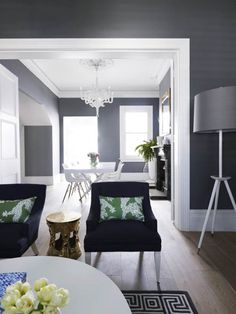 Elegant and Luxurious Interior Dining Room Design with Grey and White Combination.