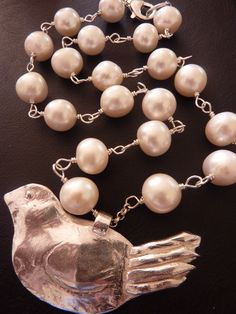 round, freshwater pearls double-wrapped in sterling silver wire by hand... 'cheeky bird' hand-moulded from precious metal clay, 99.9% fine silver