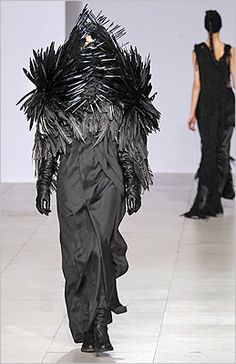 Black with feathers.