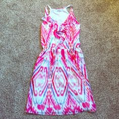 DKNYC Dress Gorgeous white DKNYC dress with pink, purple and yellow patterns! Sheer and flowing with white lining and pockets! Elastic at waist. Great condition! Only worn once! DKNYC Dresses