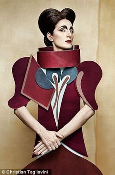 Fashion through the ages: Tagliavini uses real models for the faces, but their angular outfits are all cut from different coloured cardboard