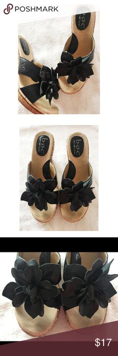"Born Leather Wedges This pair of Born Black Leather Sandal Wedges are in great condition and a size 7. They have flower in the toe and a cork wedge that measures 3.25"". Born Shoes Wedges"