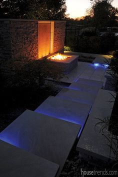 Outdoor lighting leads to a fire pit