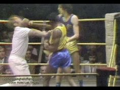 www.boxinghalloffame.com  In one of the wildest scenes ever to take place in the boxing ring - the referee in this fight gets hit with bomb and goes down - the crowd goes wild.