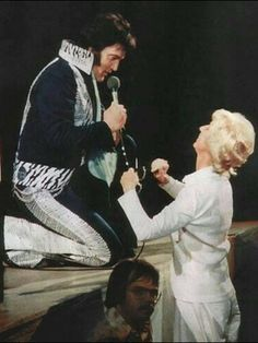 Elvis loved fans of all ages. This sweet lady has her little fists in a ball from the excitement of meeting him. So adorable.