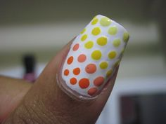 easy, little dots with bobby pin any colour!!!