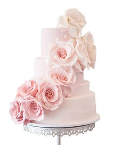 weddinginspirasi:  Ombre Rose Wedding Cake Lush ombre roses wraps around the cake with sugar lace hem. A gorgeous looking cake fit for the princess in you.Cake by Cupcakes Couture of Manhattan Beach