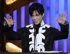 Prince accepts the award for outstanding male artist at the 38th NAACP Image Awards in Los Angeles on March 2, 2007.
