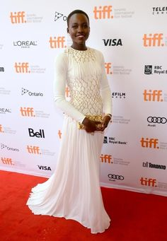 22 Times Lupita Nyong'o Proved She's A Flawless Fashion Genius | Or the time she wore this elegant white silk jersey Prada gown to the Toronto International Film Festival?