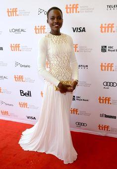 TIFF Lupita Nyong'o wore this elegant white silk jersey Prada gown to the Toronto International Film Festival