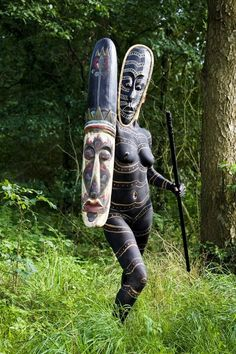 Bodypainted woman with a mask, spear and shield (more faces around the world here)