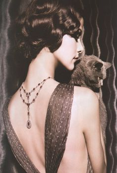 A 20s-ish back necklace for U Bean. Bonus, there's a cat in the picture too. Must be a picture of Bean back in the day..
