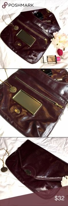 "💄 Vintage Deep Burgundy Clutch ~ With Mirror! 💄 Absolutely Love this clutch! Be unique and stand out with this CLUTCH! Has built in mirror which is so cool! In great vintage condition small discoloration on mirror frame ~ see 4th photo ~ color a bit darker in person. Stunning! Measurements 12""x 8 1/2"" don't forget to bundle if something else catches your eye! I will ship all items together. Happy Poshing! Vintage  Bags Clutches & Wristlets"
