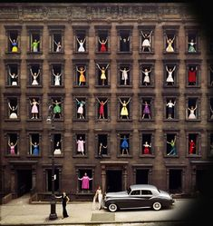 NYC. Girls in the Windows, 1960. Ormond Gigli dreamed up this photo when he realized a brownstone across from his New York apartment was being demolished. He quickly organized 43 models in formal attire to pose in the windows and ended up with an iconic photo that perfectly captures 1960′s urban mood, fashion and colour. http://VIPsAccess.com/luxury-hotels-manhattan-ny.html