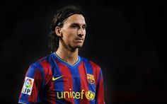 BARCELONA, SPAIN - AUGUST Zlatan Ibrahimovic of Barcelona waits for play to resume during the La Liga match between Barcelona and Sporting Gijon at the Nou Camp stadium on August 2009 in Barcelona, Spain. (Photo by Denis Doyle/Getty Images) Fc Barcelona, Milan Football, Football Gif, Good Soccer Players, Football Players, Ac Milan, Lionel Messi, Manchester City, Mens Tops