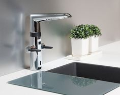 Oras Optima kitchen faucet. With a tall, turnable spout, two levers and a touchless function, a preset temperature adjustment and signal lights, and a smart dishwasher valve with automatic close, the faucet is designed to fulfil every need you can have in the kitchen.