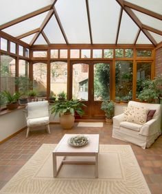 This large gazebo has a translucent roof and a red brick floor and plenty of greenery outside for privacy.