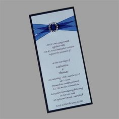 These blue wedding invitations are also available in other colours. Layered DL Invitation with Buckle and Organza Ribbon. www.kardella.com