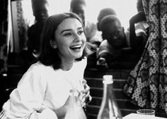 A rare laughing shot of Audrey Hepburn.  So pretty!