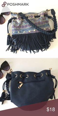 Navy boho fringe bucket bag Really cute leather purse, fringe and tassel details with a braided shoulder strap. I loved it but it just doesn't match my wardrobe enough to use! Bags Hobos
