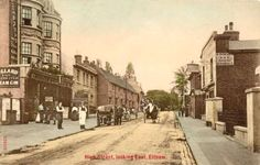 Eltham High Street c1910.  This postcard view looking east along Eltham High Street includes the Rising Sun public house on the left and A Ryde & Son's shoeing forge opposite. Increasing road traffic and suburban development of Eltham's farmlands resulted in the widening of the High Street and the demolition of many ancient buildings.