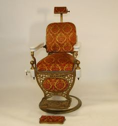 """Kochs porcelain barber chair. Chicago mfg., upholstered seat, pneumatic. 41""""H. x 25""""W. x 23""""D. Good, missing attachment for fold out footrest."""