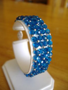 Swarovski crystal woven bracelet with sterling silver accent beads and sterling silver fish hook clasp