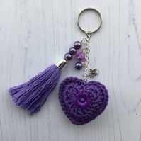 Crochet Heart and Handmade Beaded Tassel Keyring Bag Charm in Purple I have crocheted the heart in a purple cotton yarn. There is a purple flower button sewn on one side and a. Diy Hair Accessories, Crochet Accessories, Crochet Gifts, Crochet Toys, Crochet Stitches, Crochet Keychain Pattern, Sewing A Button, Small Gifts, Crochet Hearts