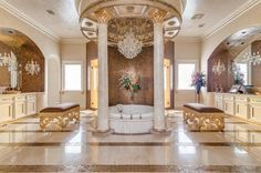 This elegant throne room is fit for a king OR queen! The bathroom is full of detail, with columns surrounding the bathtub and beautiful molding, which makes it look more like a roman bathhouse than a bathroom in a home built in 2009. The chandelier at the center of the room is a nice touch!