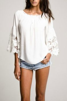 Make a statement in this beautiful blouse. Gentle elastic gathered neckline and dramatic lace net sleeves. Worn on or off the shoulders. Pair with skinny jeans for a day to eve look. One size fits sizes 0-8.   White Flower Blouse by Muche et Muchette. Clothing - Tops - Blouses & Shirts New York City