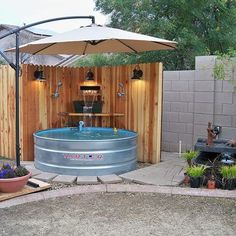 stock tank makes a cool little pool add a saltwater filter, waterfall and tons of shade, plus light for nighttime. Much better than a plastic kiddie pool. Round Stock Tank, Stock Tank Pool, Round Galvanized Stock Tank, Galvanized Tub, Outdoor Fun, Outdoor Spaces, Outdoor Living, Outdoor Decor, Rustic Outdoor