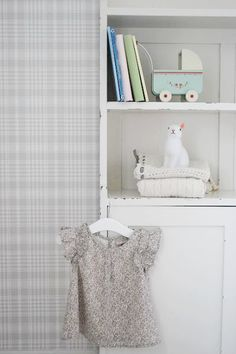 Love the look of a neutral soft plaid with baby stuff