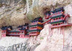Hanging Temple Built in 491, Hanging Monastery is an architectural wonder because it hangs on the west cliff of Jinxia Gorge more than 50 meters above the ground, China