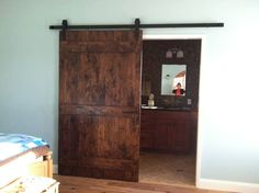 Almost two years ago we saw an article featuring barn doors in a design magazine. When we tore into our master bedroom and bath in 2013, it became a no brainer that we wanted to rustic look and feel of a barn door for the new master bath we were building. We also added a pair of smaller doors, finished similarly, to our new walk-in closet, maximizing the amount of space we have and extending the rustic look we wanted to capture for our space.