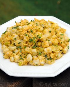 Mote pillo consists of hominy sautéed with onions, garlic, achiote, eggs, milk, chives and cilantro or parsley, and served with hot black coffee and slices of fresh cheese