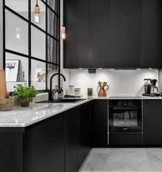 Amazing black kitchen! Love the contrast with the floorboards. Add ...