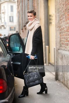 Model Taylor Hill exits the Trussardi show with a Dolce & Gabbana bag on Day 5 of Milan Fashion Week FW15 on March 1, 2015 in Milan, Italy.