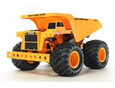 The Tamiya 1/24 RC Heavy Dump Truck Model Kit.  This R/C assembly kit depicting a dump truck modeled upon those which do the heavy work in locations like quarries and large-scale construction sites. The model is based on the popular gear-driven GF-01 chassis.