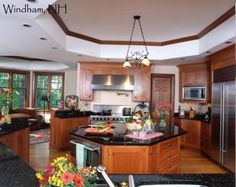 Kitchen Island- octagonal island, built in dishwasher, lots of storage, black granite, natural cherry cabinets