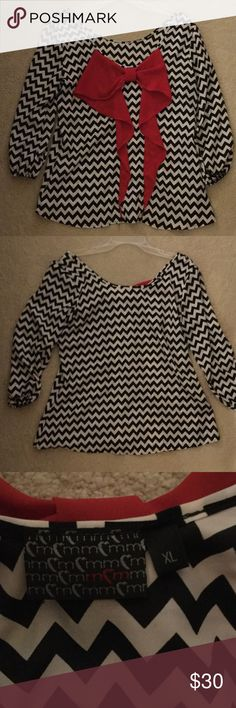Black and White Chevron Top Cute Chevron striped top with red bow in back. Perfect condition. Peach Love Cream Tops