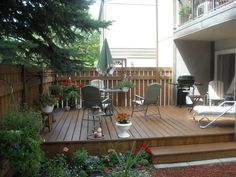 This ground level deck has nice landscaping.