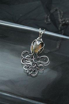 Silver pendant Octop
