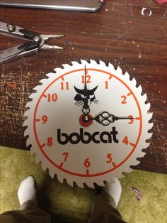 Bobcat clock on saw blade. Painted then decaled.